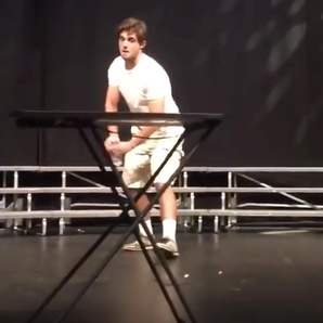 Mike Senatore flips a bottle at school talent show