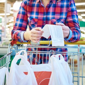 Woman supermarket trolley stock image istock