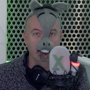 Dominic dressed in a donkey mask
