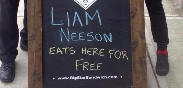 Liam Neeson eats here for free sign